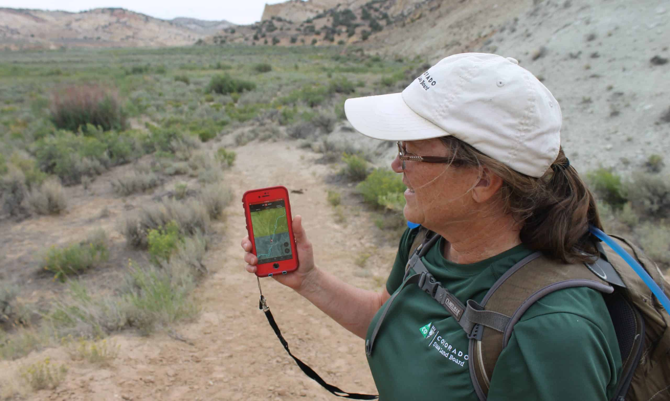 Colorado State Trust Land Board Conservation Services Manager, Mindy, uses onX in the field.