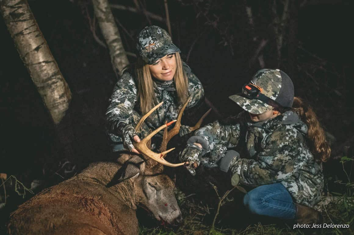 Mother and daughter hunting with whitetail buck in the Northeast.