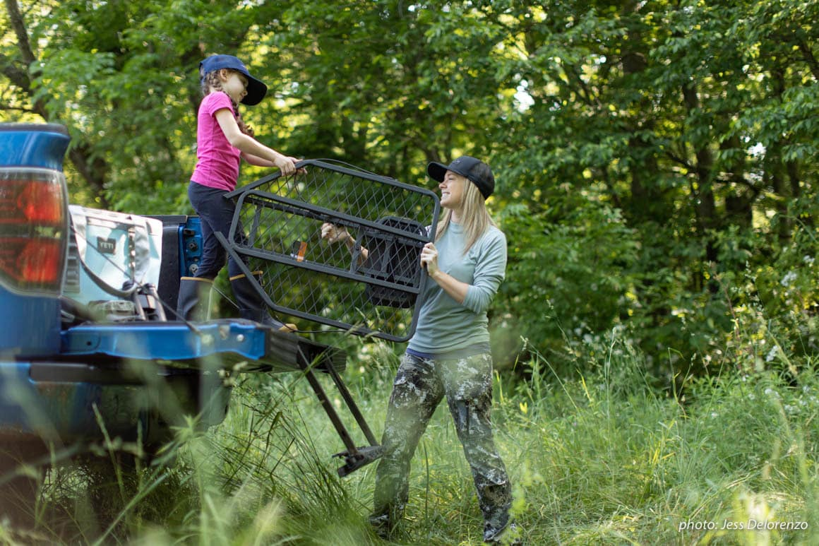 Mother and daughter setting up a treestand in Pennsylvania for hunting.