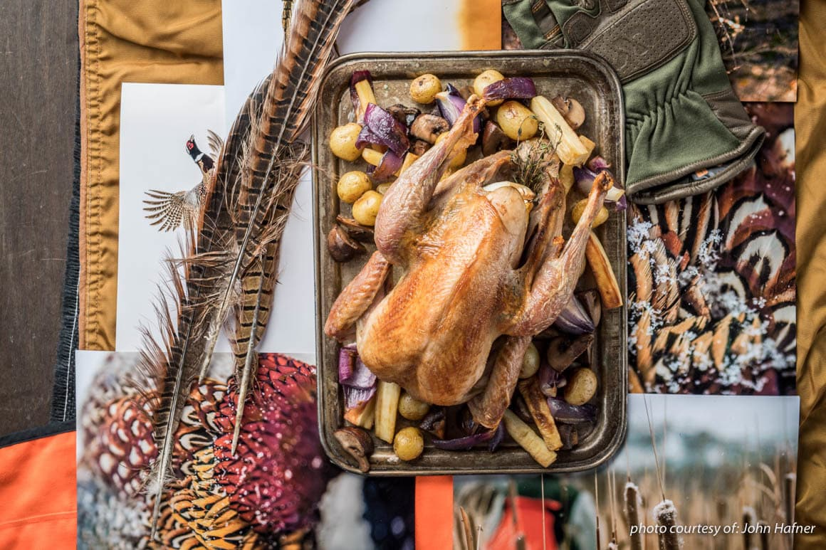 Roast pheasant on a table with festive decorations. Recipe from Steven Rinella's The MeatEater Cookbook.