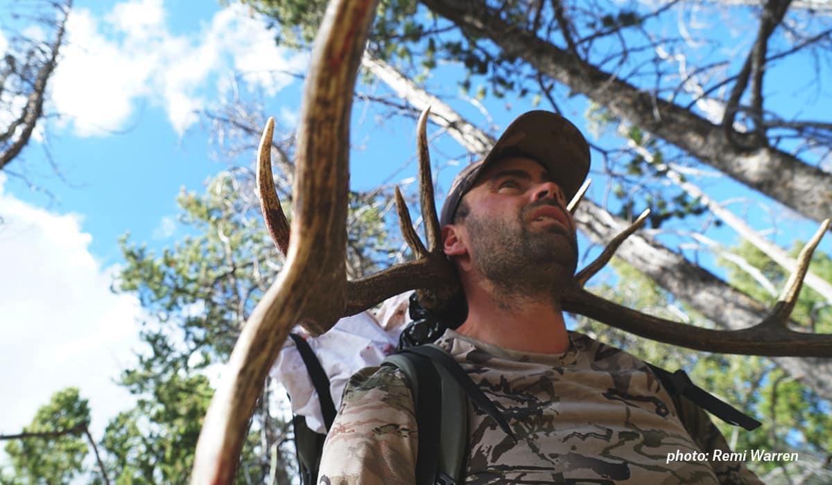 Remi Warren packs out an elk.