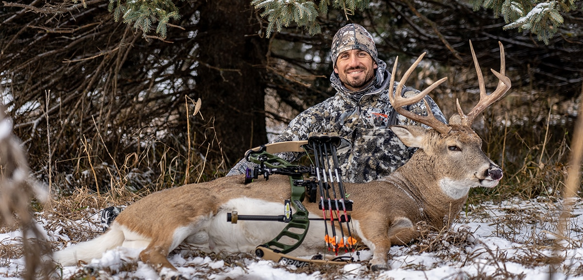 Sam Soholt with an archery deer harvested in the snow.