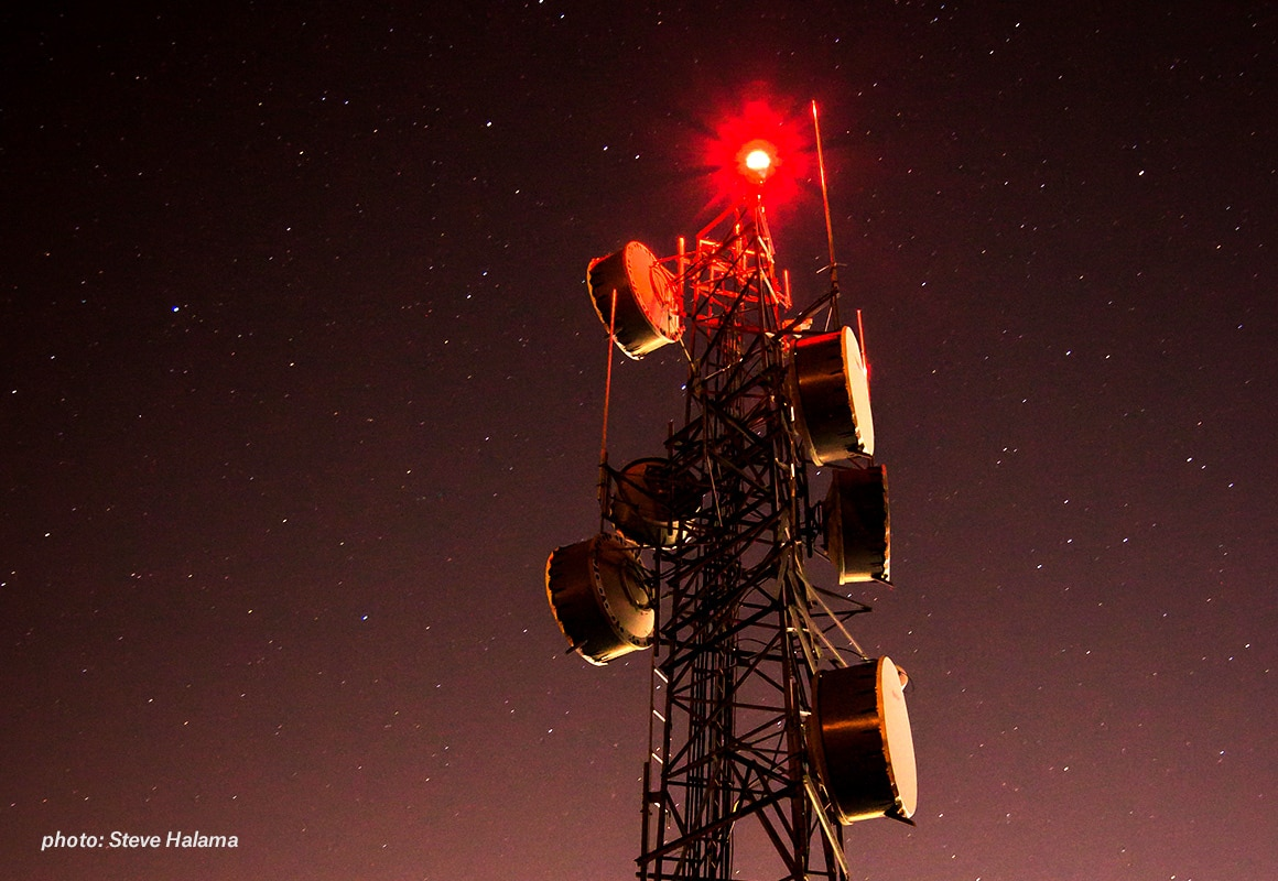 Cell tower with night sky background