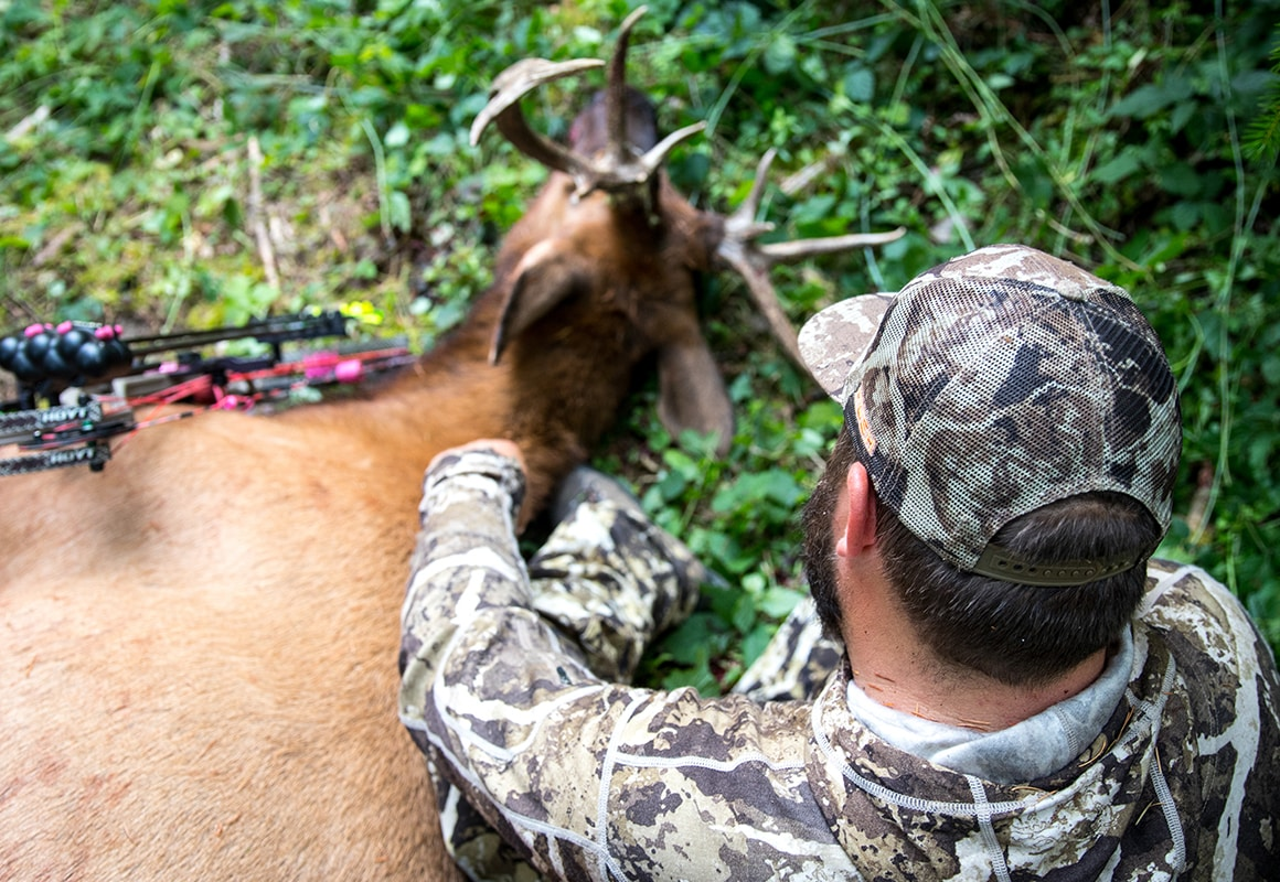 Man with elk shot while bowhunting using onX Hunt Possible Access Layer.