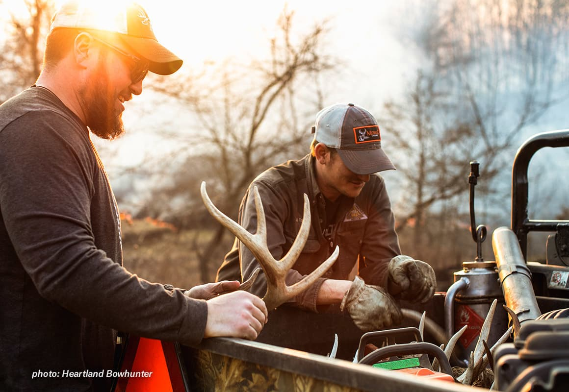 Two men shed hunting in the springtime.