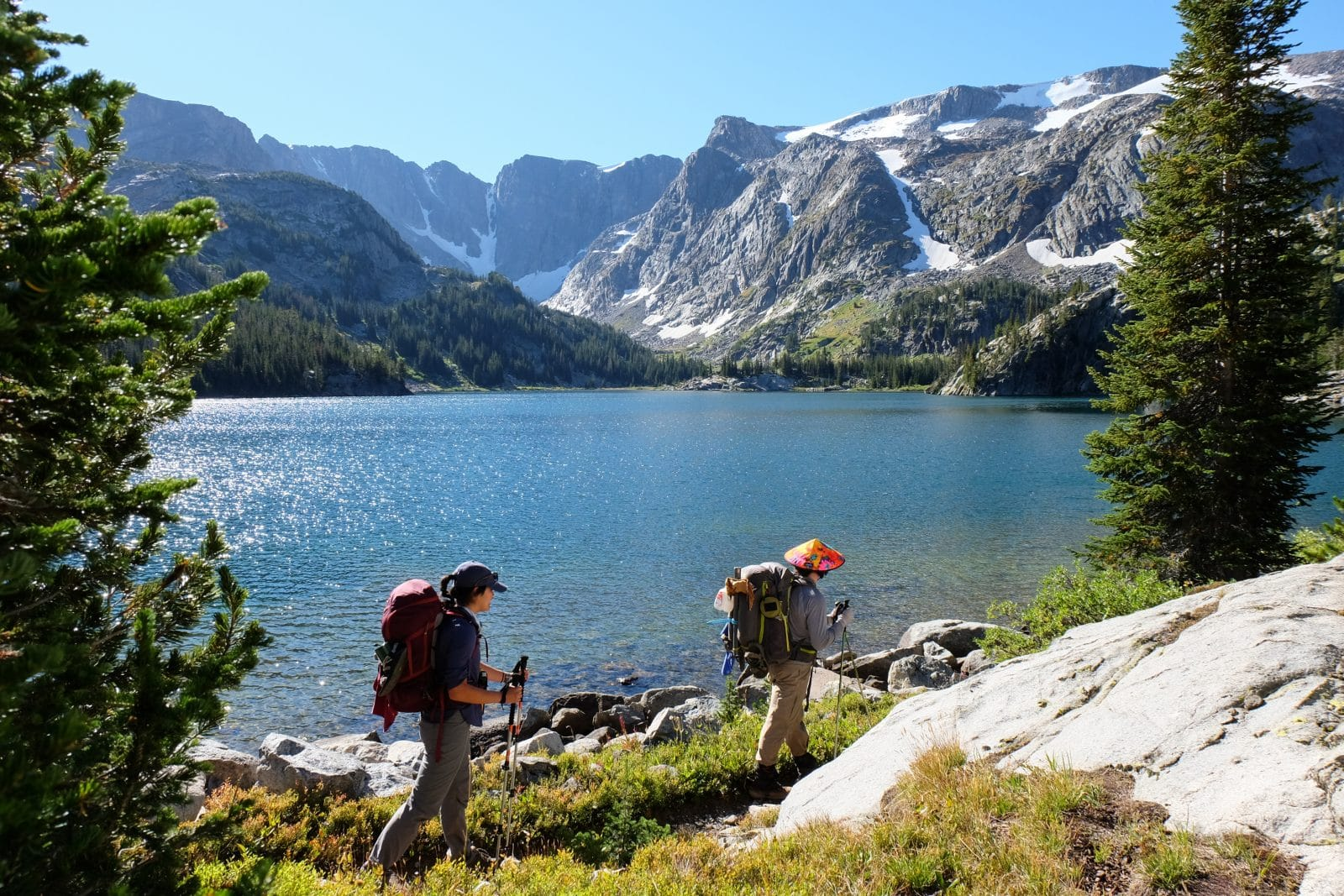 alpine lake with hikers