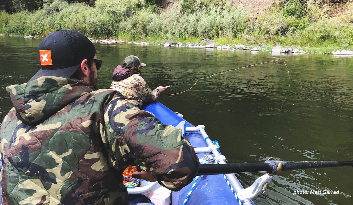 Army veteran and onX staffer Zach Condon fishing in his raft with a friend.