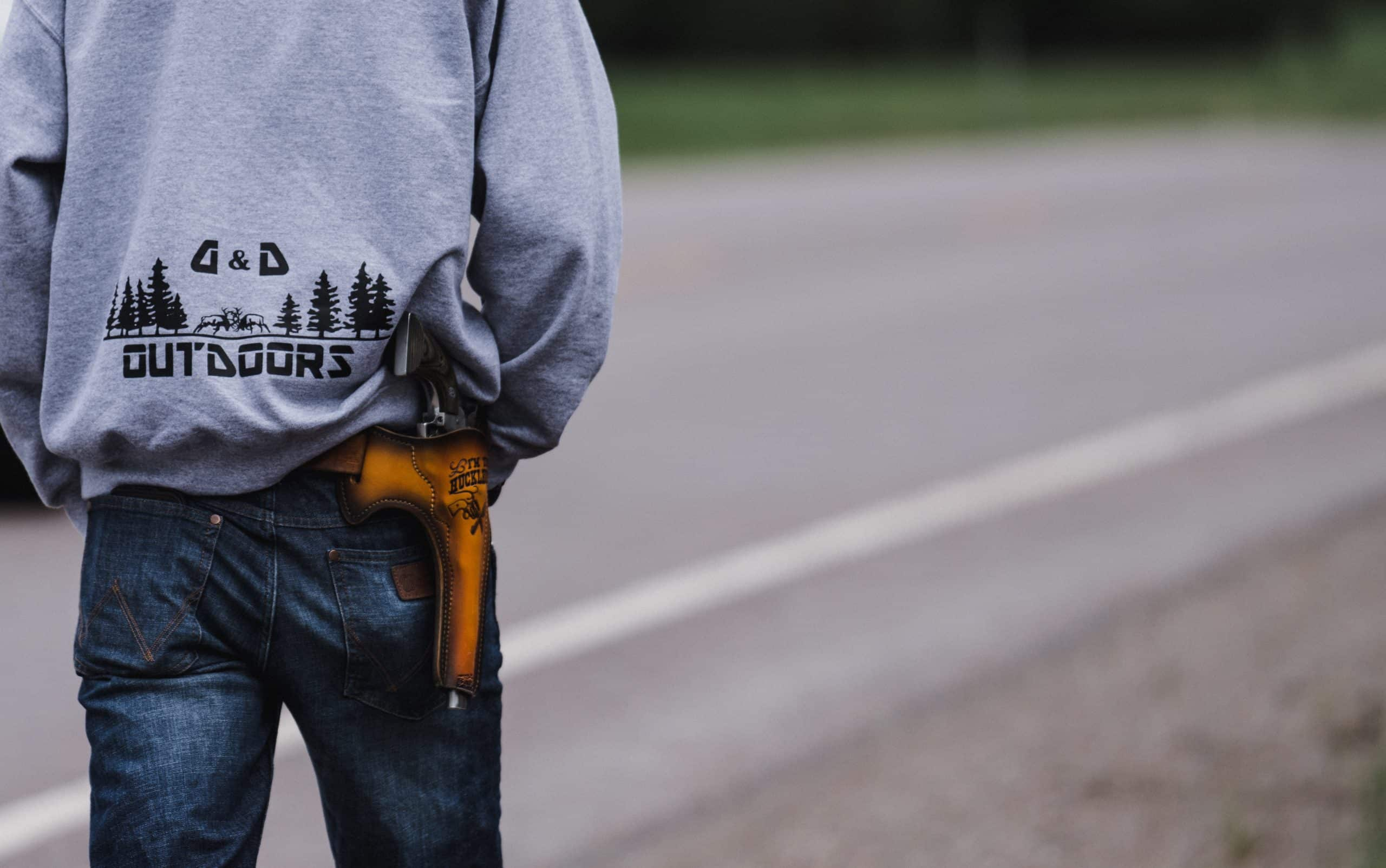 A shed hunter with a pistol in a custom holster on his hip.