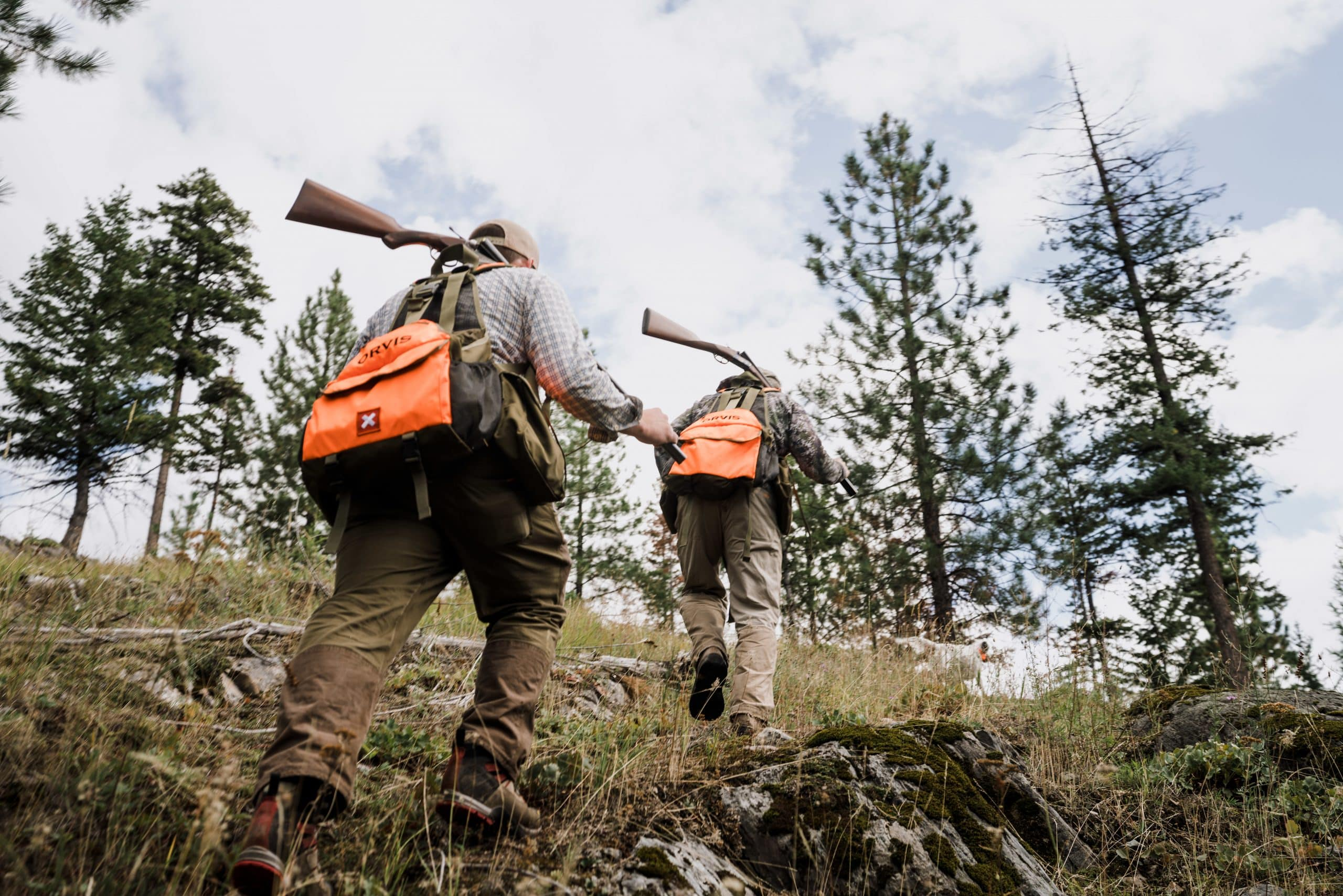 Two hunters begin the climb for blue grouse in northwest Montana.
