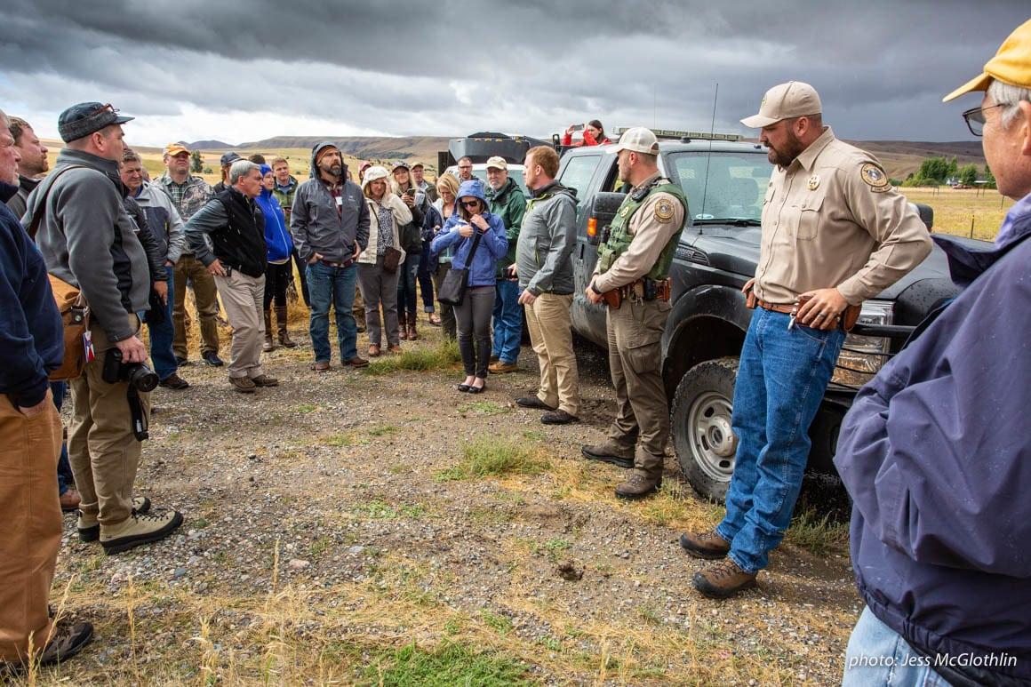 Media and outdoor industry professionals view landlocked public lands near Bozeman, Montana.