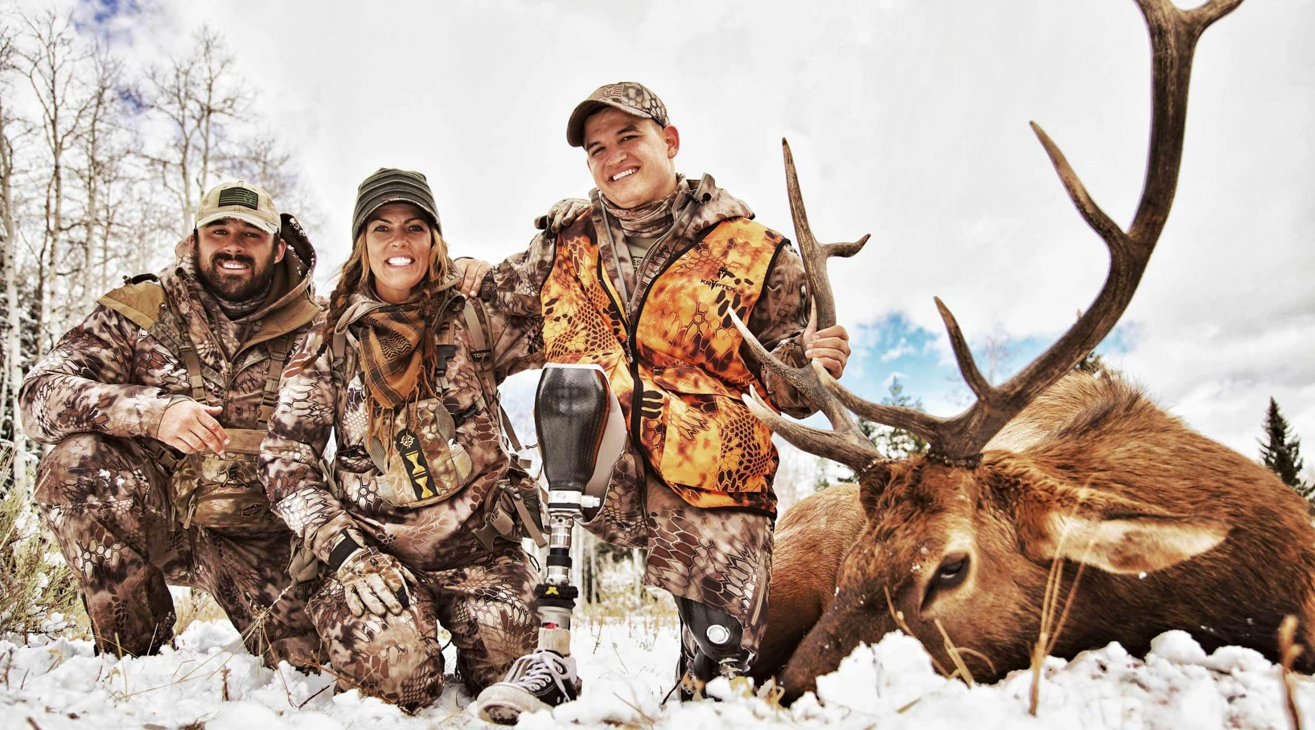 Jana Waller and friends with a late-season bull elk shot in the snow in Montana with former Navy SEAL Bo Reichenbach.