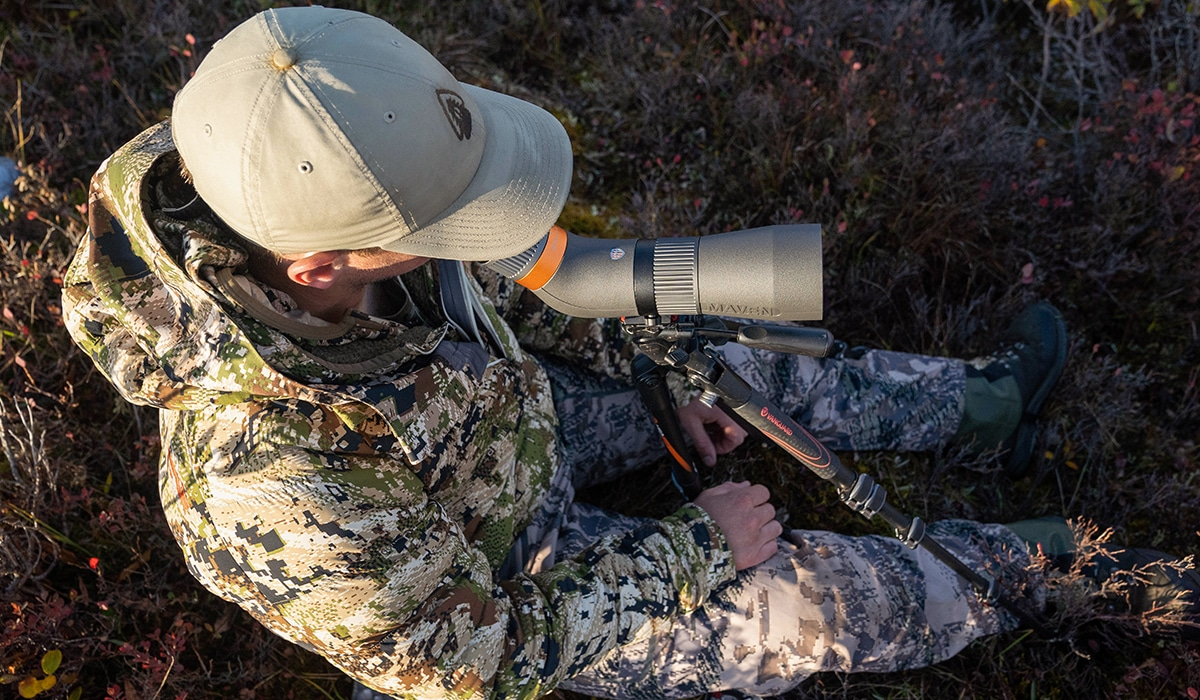 A hunter glassing for caribou while hunting in Alaska.