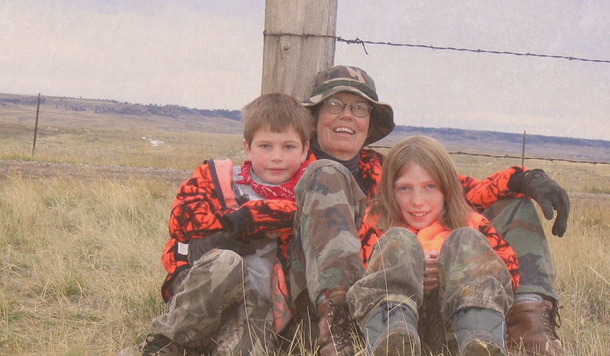 Generations of Montana hunters rest in the field during an antelope hunt.