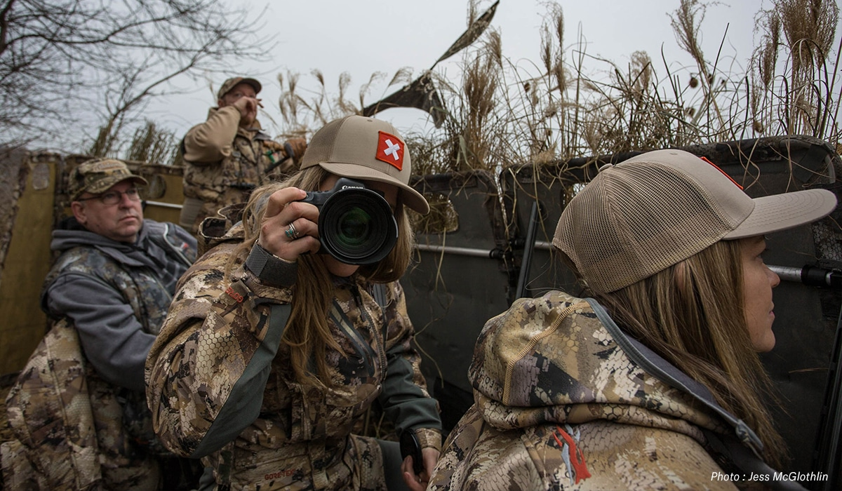 Female and male hunters in a goose blind in New Jersey.